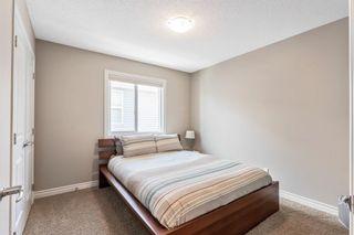 Photo 19: 205 Heritage Boulevard: Cochrane Detached for sale : MLS®# A1122442