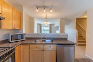 Photo 17: 119 Toscana Gardens NW in Calgary: Tuscany Row/Townhouse for sale : MLS®# A1121039