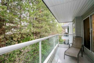 """Photo 17: 404 2733 ATLIN Place in Coquitlam: Coquitlam East Condo for sale in """"ATLIN COURT"""" : MLS®# R2232992"""