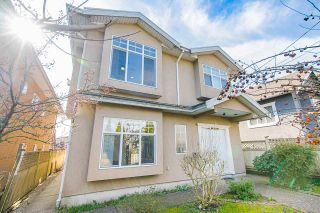 Photo 1: 7711 CANADA Way in Burnaby: Edmonds BE House for sale (Burnaby East)  : MLS®# R2550186
