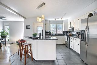 Photo 10: 687 Brookpark Drive SW in Calgary: Braeside Detached for sale : MLS®# A1093005
