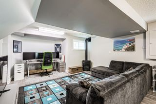 Photo 34: 104 Woodmark Crescent SW in Calgary: Woodbine Detached for sale : MLS®# A1128002