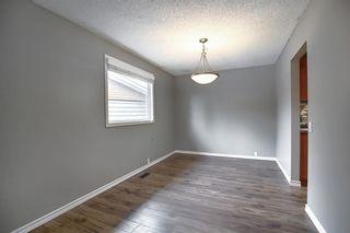Photo 9: 844 LAKE LUCERNE Drive SE in Calgary: Lake Bonavista Detached for sale : MLS®# A1034964