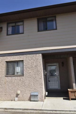 Photo 1: 7 1706 22 Avenue: Didsbury Row/Townhouse for sale : MLS®# A1112062