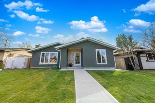 Photo 2: 944 Parkvalley Way SE in Calgary: Parkland Detached for sale : MLS®# A1153564