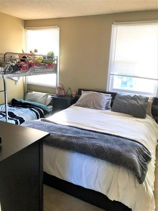Photo 12: 22 Woodhill Road SW in Calgary: Woodlands Row/Townhouse for sale : MLS®# A1072273