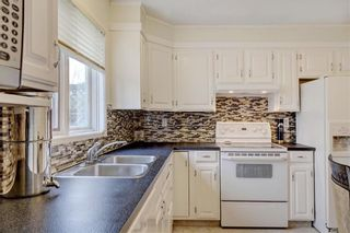 Photo 9: 43 STRATHEARN Crescent SW in Calgary: Strathcona Park Detached for sale : MLS®# C4183952