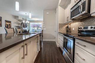 Photo 8: 270 Quarry Park Boulevard SE in Calgary: Douglasdale/Glen Row/Townhouse for sale : MLS®# A1141853