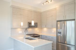 """Photo 5: 406 2120 GLADWIN Road in Abbotsford: Central Abbotsford Condo for sale in """"THE ONYX AT MAHOGANY"""" : MLS®# R2614339"""