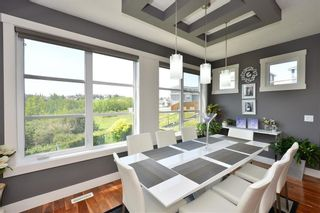 Photo 8: 697 TUSCANY SPRINGS Boulevard NW in Calgary: Tuscany Detached for sale : MLS®# A1060488