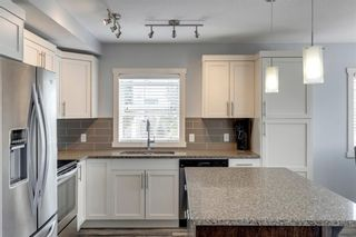 Photo 12: 912 Redstone View NE in Calgary: Redstone Row/Townhouse for sale : MLS®# A1136349