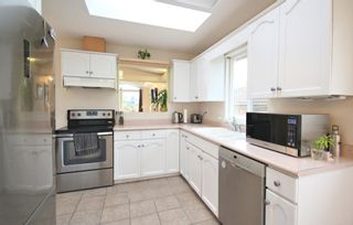 Photo 6: 7456 MARY Avenue in Burnaby: Edmonds BE 1/2 Duplex for sale (Burnaby East)  : MLS®# R2602810