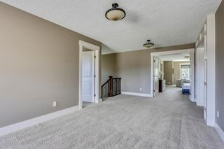 Photo 19: 104 Aspen Cliff Close SW in Calgary: Aspen Woods Detached for sale : MLS®# A1147035