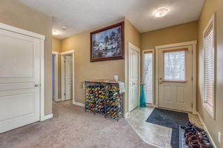 Photo 4: 1401 281 COUGAR RIDGE Drive SW in Calgary: Cougar Ridge Row/Townhouse for sale : MLS®# A1070231