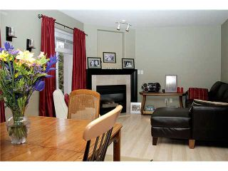 Photo 2: 17 2538 PITT RIVER Road in Port Coquitlam: Mary Hill Townhouse for sale : MLS®# V881869
