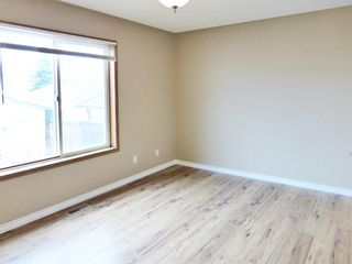 Photo 14: 107 Mt Allan Circle SE in Calgary: McKenzie Lake Detached for sale : MLS®# A1068557