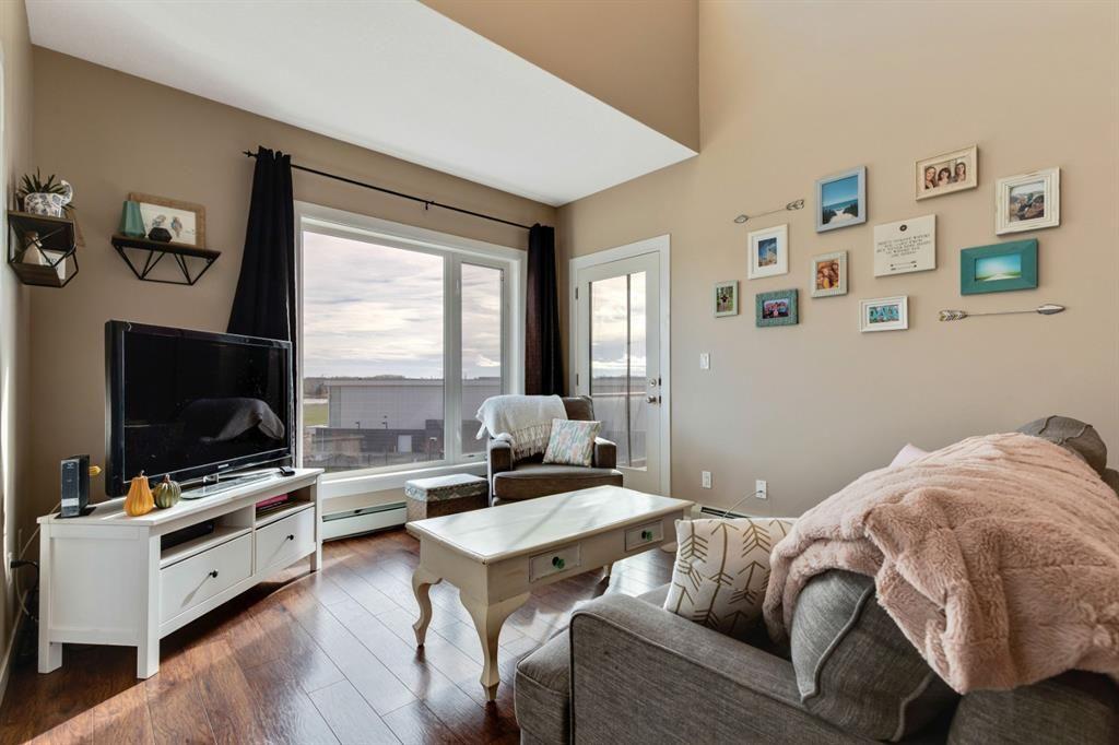 Main Photo: 1409 604 East Lake Boulevard NE: Airdrie Apartment for sale : MLS®# A1057063