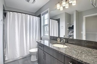Photo 25: 731 101 Sunset Drive: Cochrane Row/Townhouse for sale : MLS®# A1077505