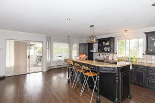 Photo 3: 8738 143A Street in Surrey: Bear Creek Green Timbers House for sale : MLS®# R2606825