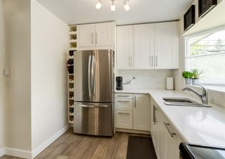 Photo 12: 5812 21 Street SW in Calgary: North Glenmore Park Detached for sale : MLS®# A1128102