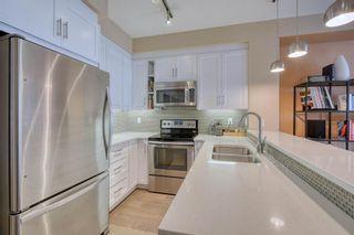 Photo 11: 409 25 Auburn Meadows Avenue SE in Calgary: Auburn Bay Apartment for sale : MLS®# A1067118