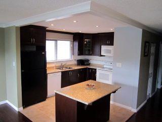 Photo 4: 833 PRAIRIE Avenue in Port Coquitlam: Lincoln Park PQ House for sale : MLS®# V901800