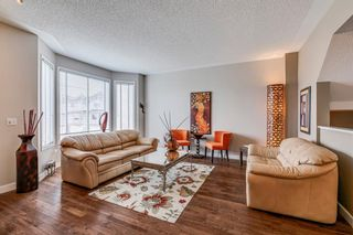 Photo 2: 109 Country Hills Gardens NW in Calgary: Country Hills Semi Detached for sale : MLS®# A1136498