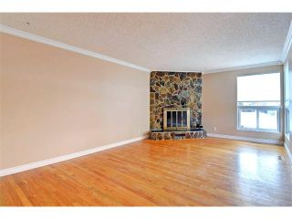 Photo 10: 6415 LONGMOOR Way SW in Calgary: Lakeview House for sale : MLS®# C4102401