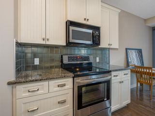 Photo 7: 27 Cougar Plateau Way SW in Calgary: Cougar Ridge Detached for sale : MLS®# A1113604