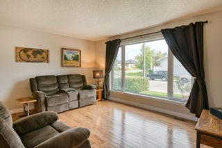 Photo 7: 131 Queensland Circle SE in Calgary: Queensland Detached for sale : MLS®# A1148253