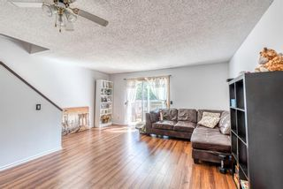Photo 5: 37 Range Gardens NW in Calgary: Ranchlands Row/Townhouse for sale : MLS®# A1118841