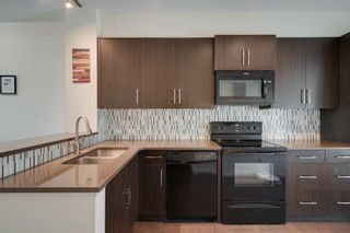 Photo 12: 111 Ascot Point SW in Calgary: Aspen Woods Row/Townhouse for sale : MLS®# A1144877