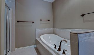 Photo 15: 72 Elysian Crescent SW in Calgary: Springbank Hill Semi Detached for sale : MLS®# A1148526