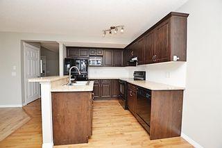 Photo 5: 22 Cimarron Grove Rise: Okotoks Detached for sale : MLS®# A1117317