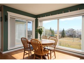 Photo 14: 51 GLENEAGLES View: Cochrane House for sale : MLS®# C4008842
