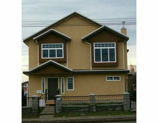 Photo 1: 7449 Main Street in Vancouver: South Vancouver 1/2 Duplex for sale (Vancouver East)  : MLS®# V622304
