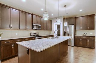 Photo 7: 1100 Brightoncrest Green SE in Calgary: New Brighton Detached for sale : MLS®# A1060195