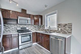 Photo 11: 30 MACEWAN RIDGE Place in Calgary: MacEwan Glen Detached for sale : MLS®# A1092445