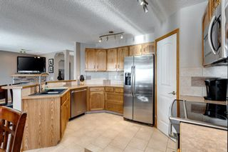 Photo 5: 134 Coverton Heights NE in Calgary: Coventry Hills Detached for sale : MLS®# A1071976