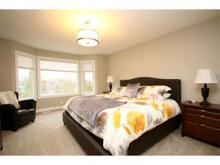 Photo 24: 156 GLENEAGLES Close: Cochrane House for sale : MLS®# C4018066