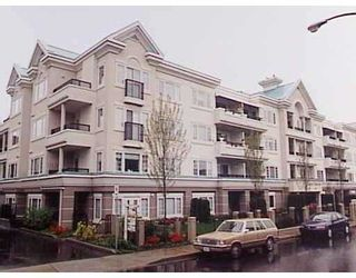 """Photo 1: 101 55 BLACKBERRY Drive in New Westminster: Fraserview NW Condo for sale in """"QUEENS PARK"""" : MLS®# V641994"""
