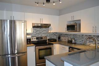 """Photo 7: 3155 W 4TH Avenue in Vancouver: Kitsilano Condo for sale in """"BRIDGEWATER"""" (Vancouver West)  : MLS®# R2142418"""