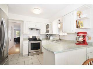 """Photo 6: 878 E 23RD AV in Vancouver: Fraser VE House for sale in """"CEDAR COTTAGE"""" (Vancouver East)  : MLS®# V1022949"""
