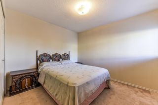 """Photo 12: 105 10091 156 Street in Surrey: Guildford Townhouse for sale in """"Guildford Park"""" (North Surrey)  : MLS®# R2321879"""