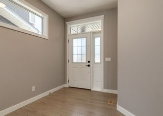 Photo 5: 203 Crestridge Hill SW in Calgary: Crestmont Detached for sale : MLS®# A1105863