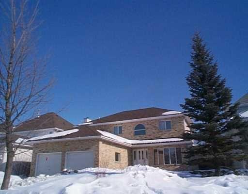Main Photo: 69 MULLIGAN Bay in WINNIPEG: River Heights / Tuxedo / Linden Woods Single Family Detached for sale (South Winnipeg)  : MLS®# 2502352
