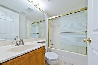 Photo 18: BRIDLEWOOD PL SW in Calgary: Bridlewood House for sale