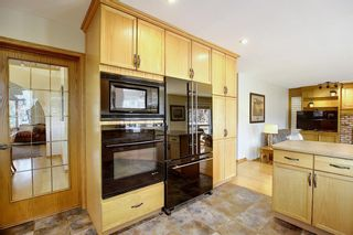 Photo 10: 84 Strathdale Close SW in Calgary: Strathcona Park Detached for sale : MLS®# A1046971