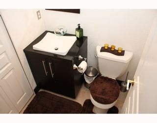 """Photo 9: 224 1465 PARKWAY Boulevard in Coquitlam: Westwood Plateau Townhouse for sale in """"SILVER OAKS"""" : MLS®# V787781"""
