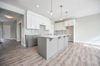 Photo 1: 179 Edgemont Road in Edmonton: Zone 57 House for sale : MLS®# E4261351